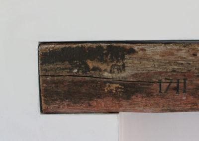 balk met inscriptie